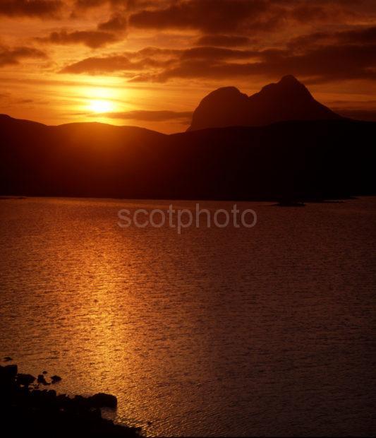 Sunset Over Cam Loch NrElphin Towards Ben Suilven Sutherland