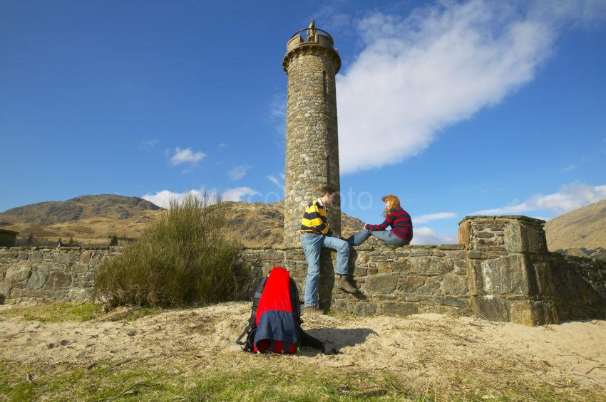 Couple Relax At Glenfinnan Monument Lochaber