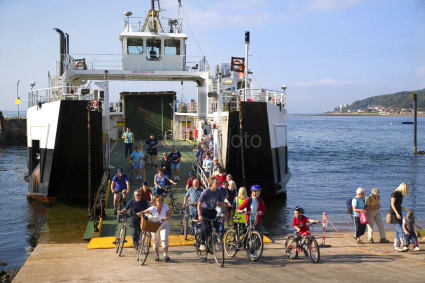 WY3Q9933 Cyclist Disembark From Cumbrae Ferry 47MG