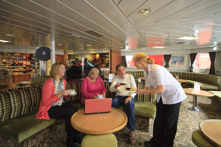 Passengers On Cal Mac Ferry With Laptop