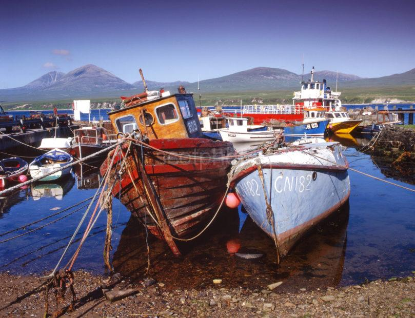 Lots Of Boats In Port Ascaig Harbour With Paps Of Jura In View ISLAY