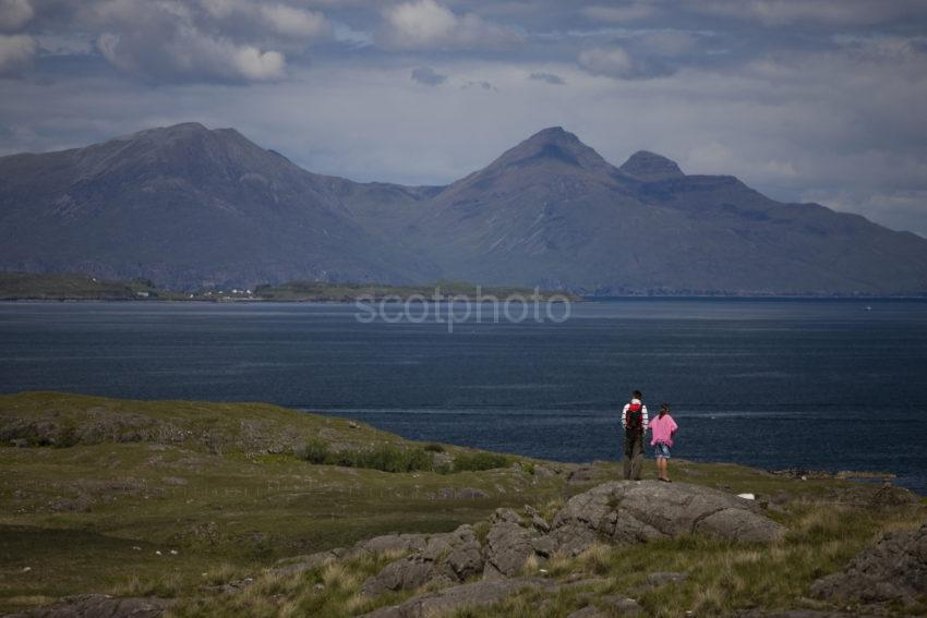 I5D6923 Tourists Admire View Towards Rum From Sanna Ardnamurchan