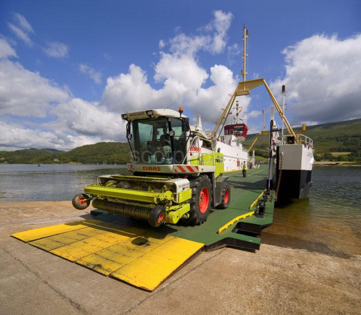 Agriculture Machinery Drives Off The Colintrive Ferry On Bute