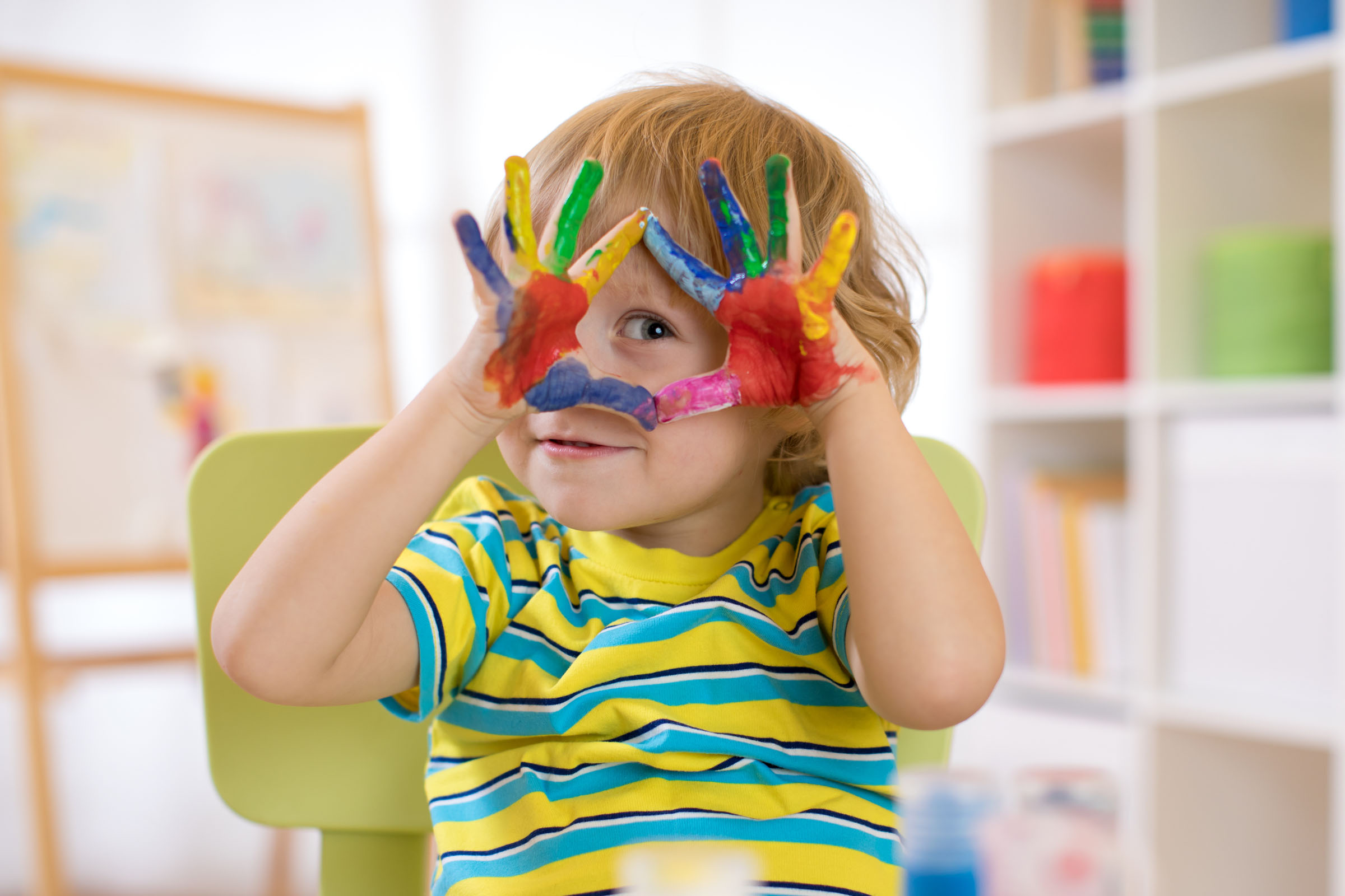 Preschool Pals boy with paint covered hands