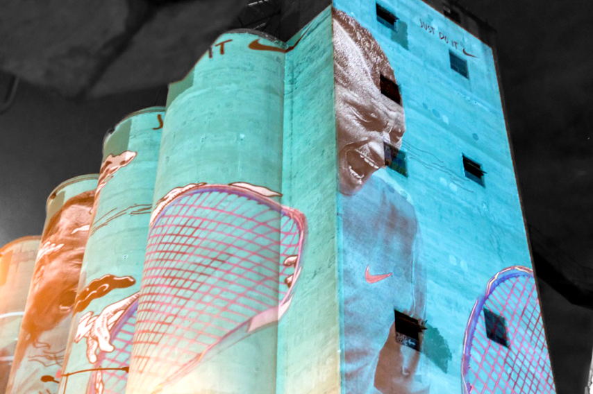 Nike brand projected onto silo