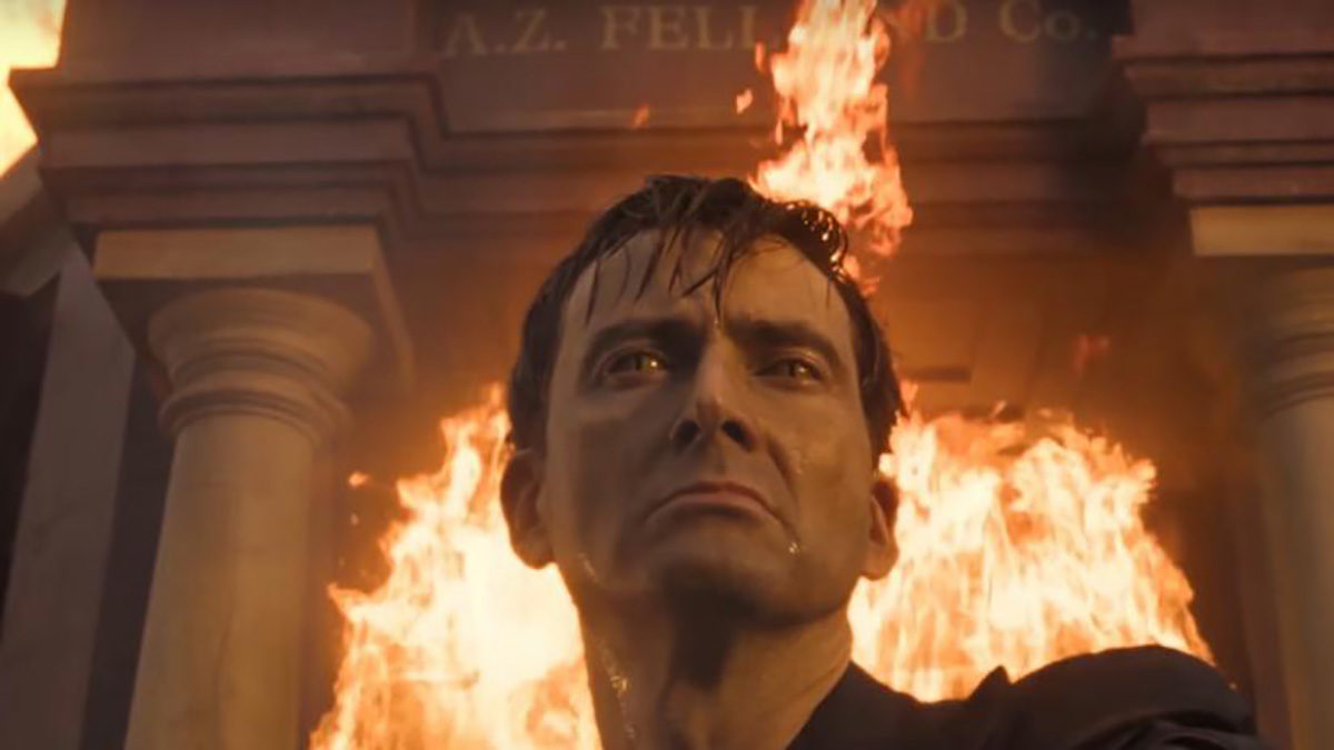 Anthony Crowley leaves Aziraphale's bookstore surrounded by fire.