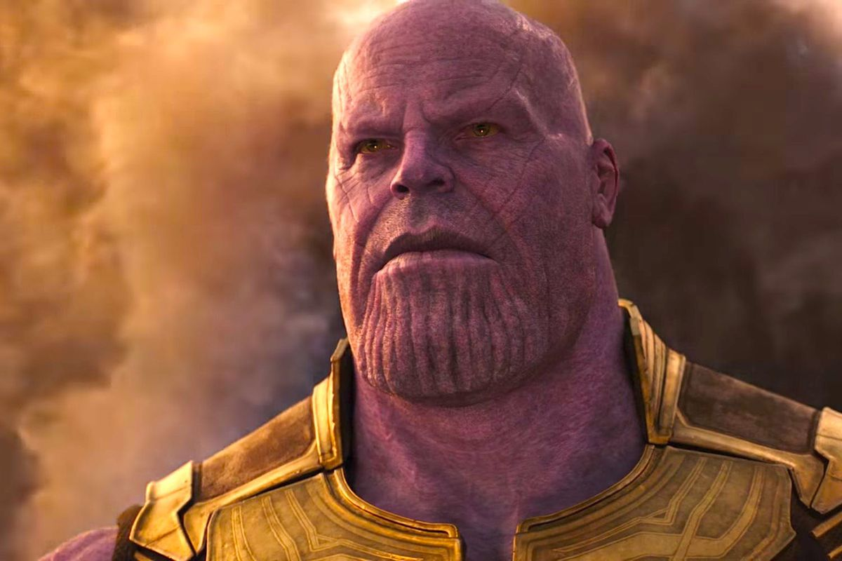 Thanos emerges from the dust of his home planet, Titan.