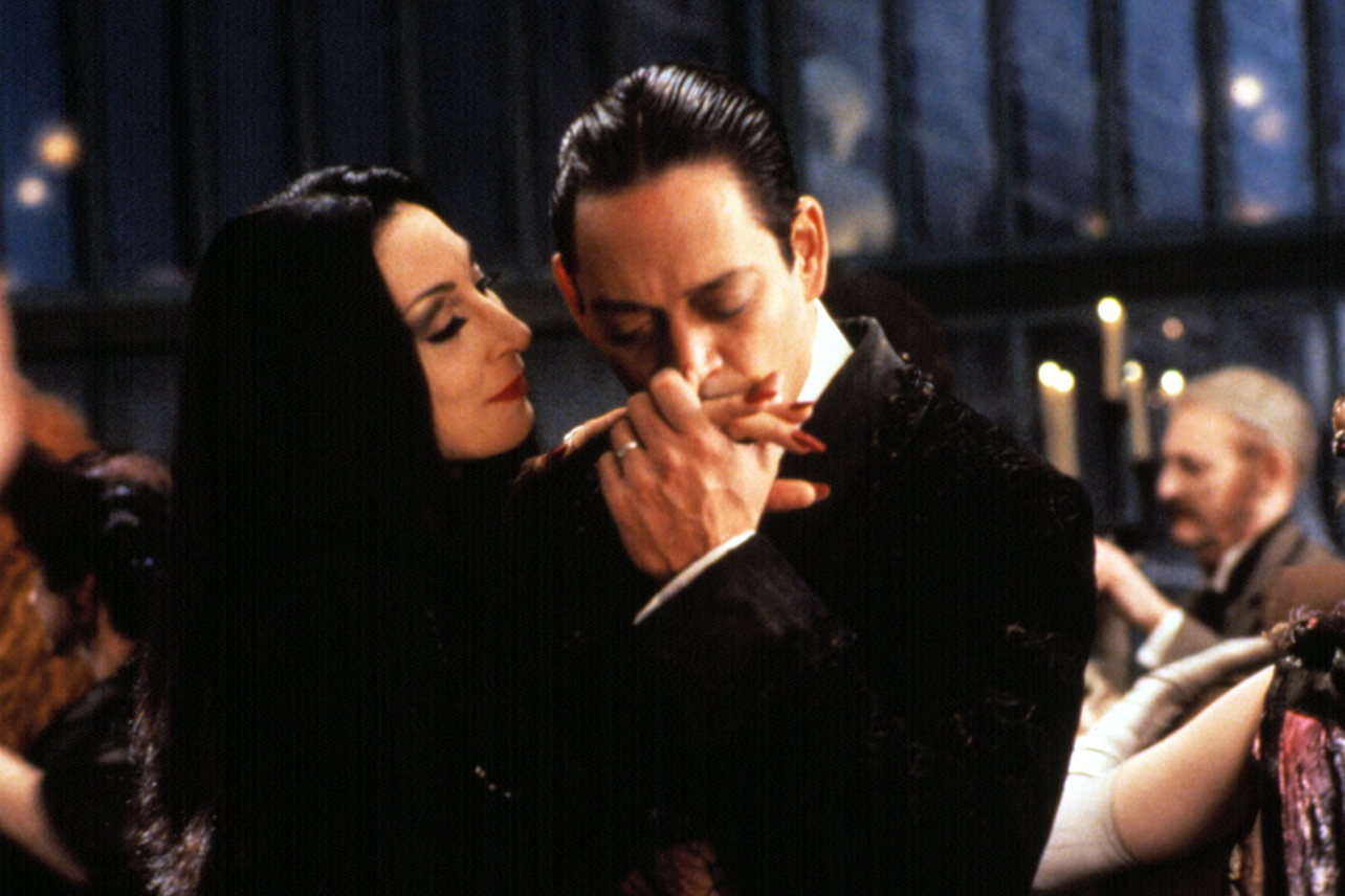 """Gomez kissing Morticia's hand in a scene from Paramount's 1991 film, """"The Addams Family."""""""