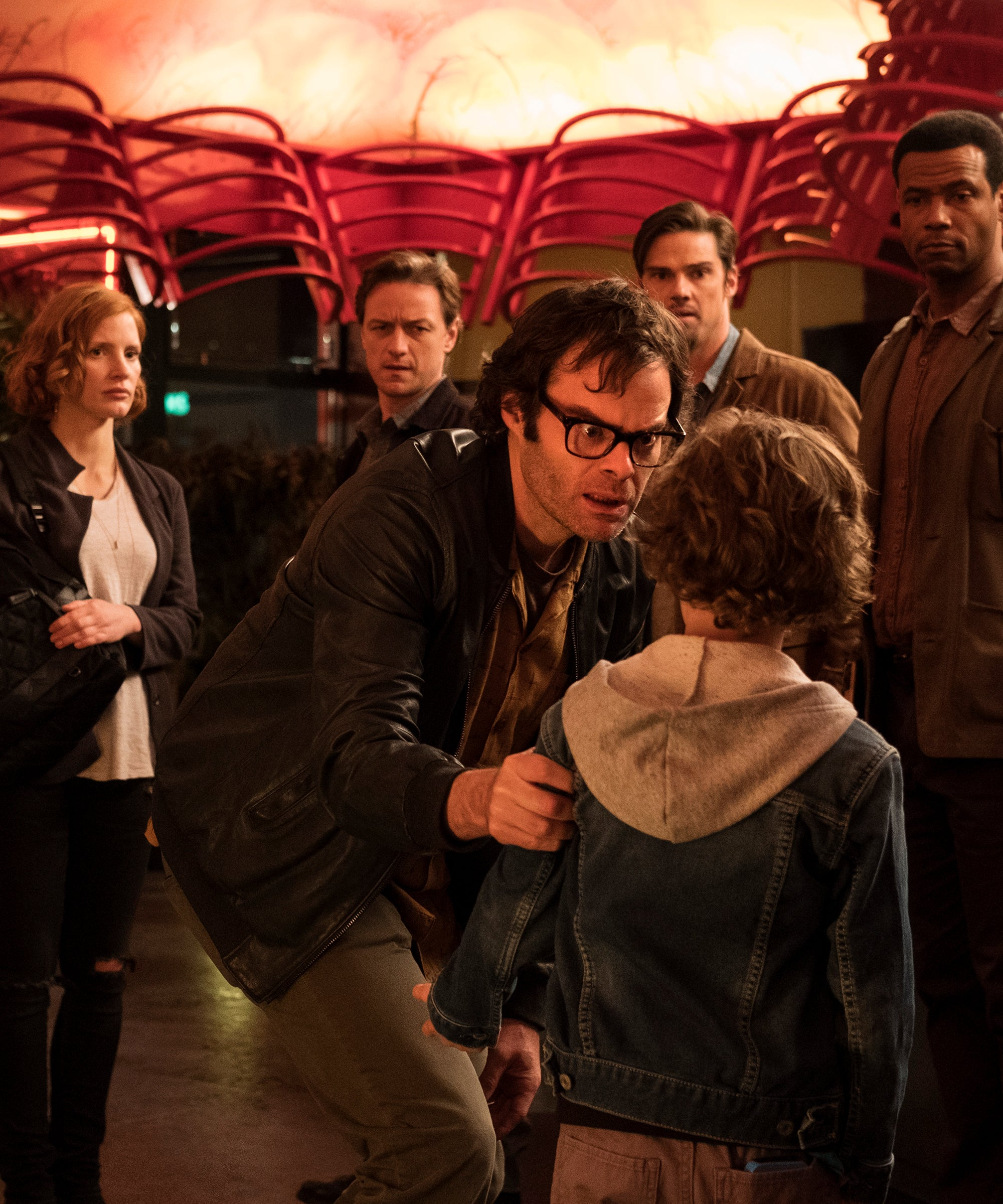 The Losers, as they stand in a restaurant, after they see each other for the first time in 27 years. Richie berates a child in IT: Chapter 2.