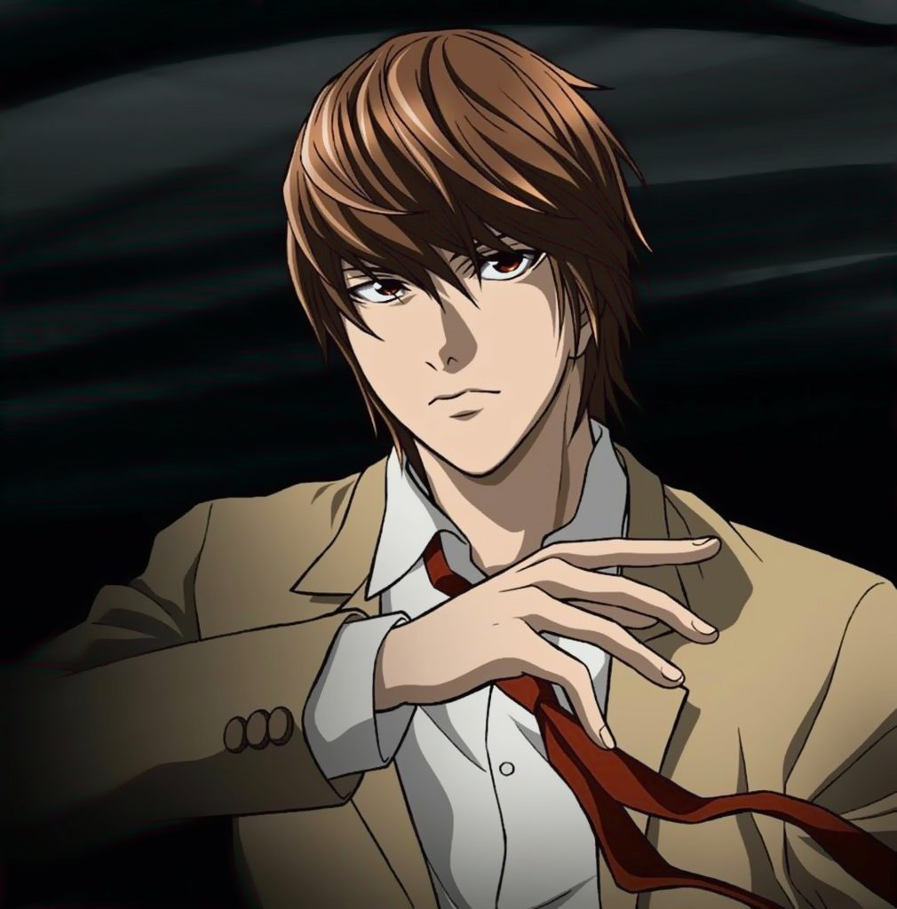 Light Yagami in his school uniform. His arm is up and his expression is mischievous.