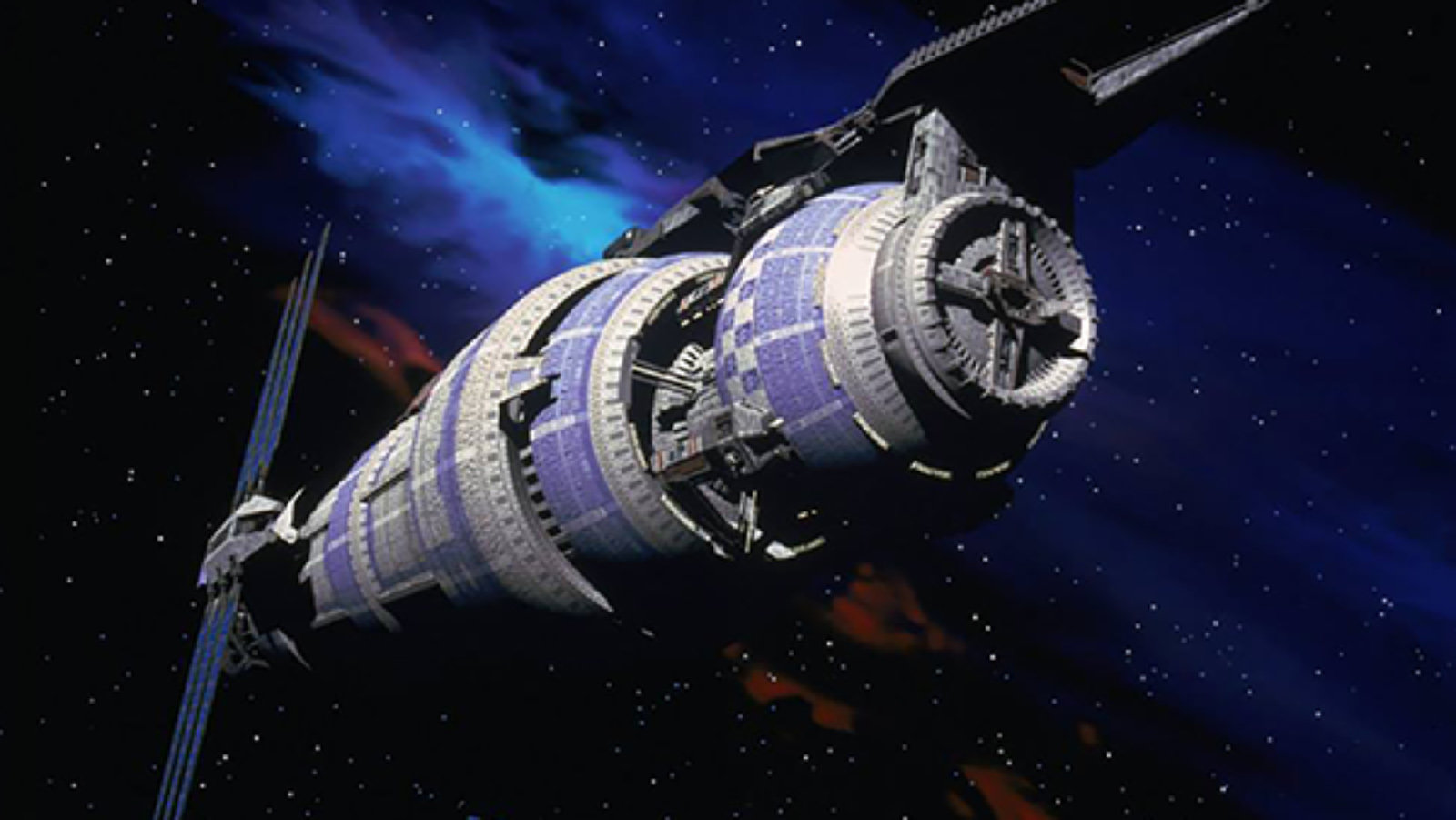 Babylon 5, the space station, stands out from the darkness of space.