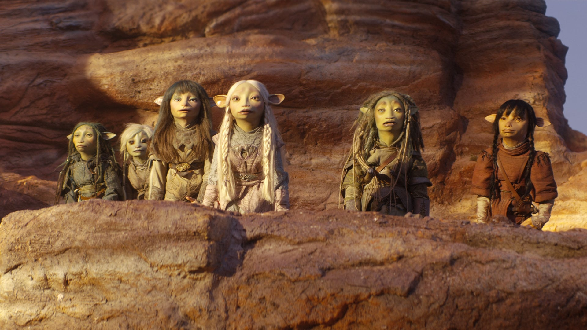 Deet, Rian, Brea and Gurjin are all lined up along the edge of a cliff with two other Gelflings.