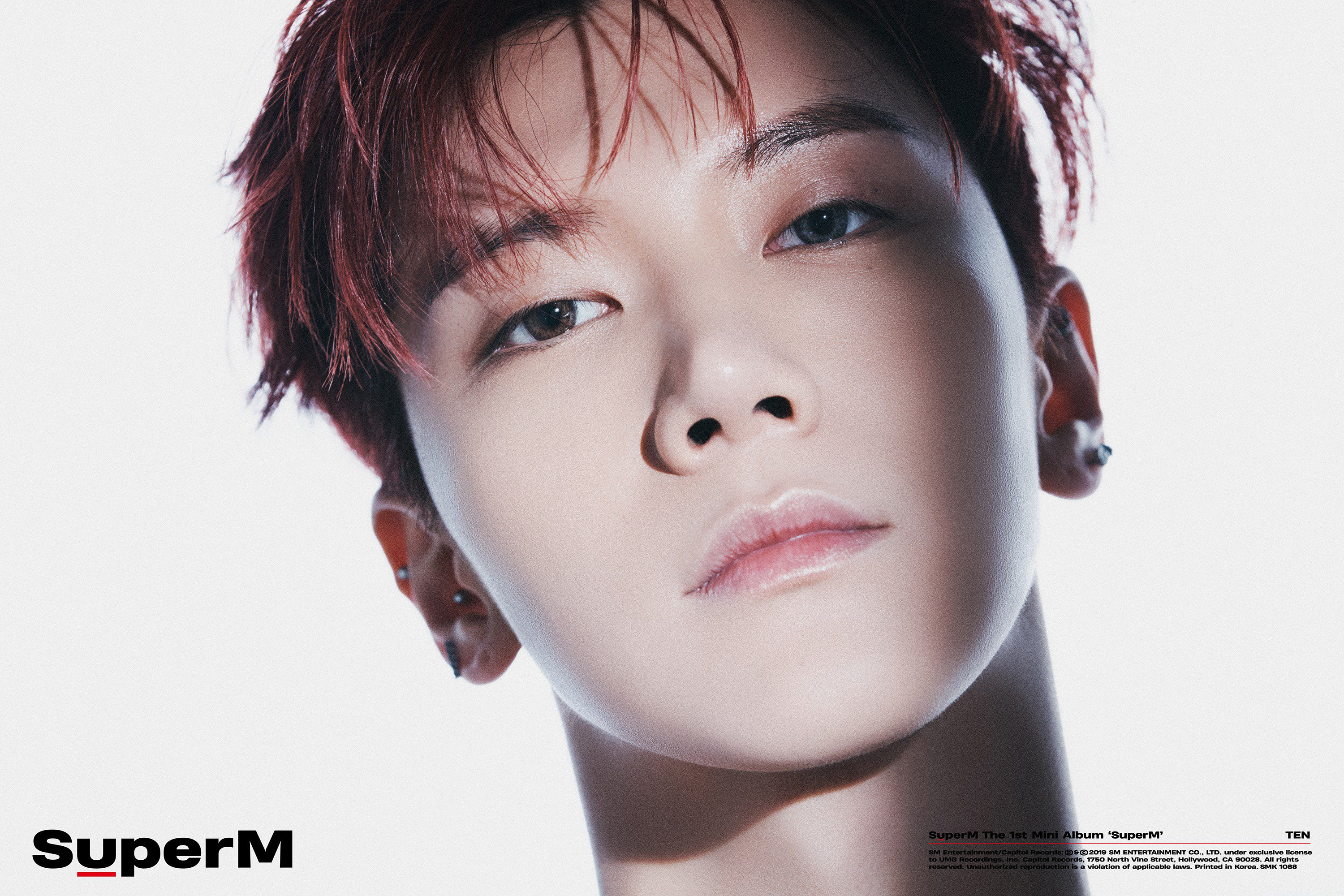 Ten flaunts his red hair and piercings in this portrait teaser photo.