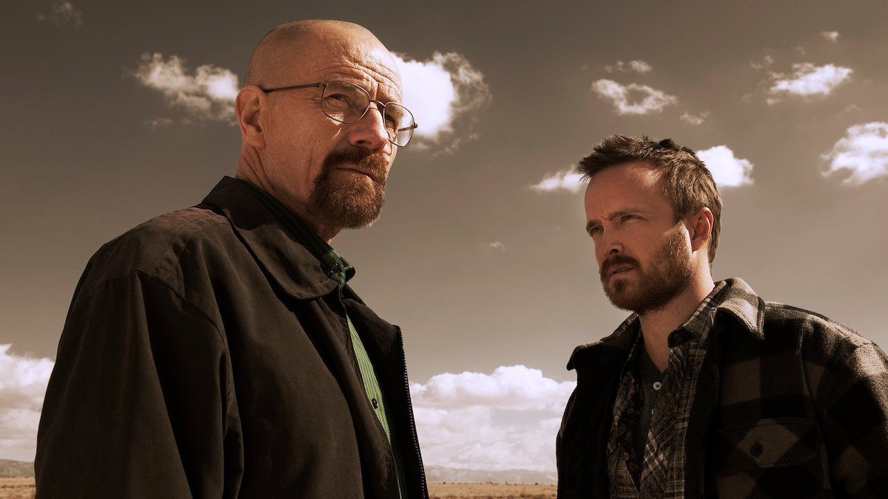 Walter White and Jesse Pinkman stare at each other.