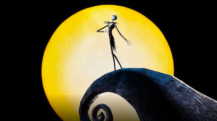 Jack Skellington, the main character of The Nightmare Before Christmas, standing on the curled mountain top next to his home.