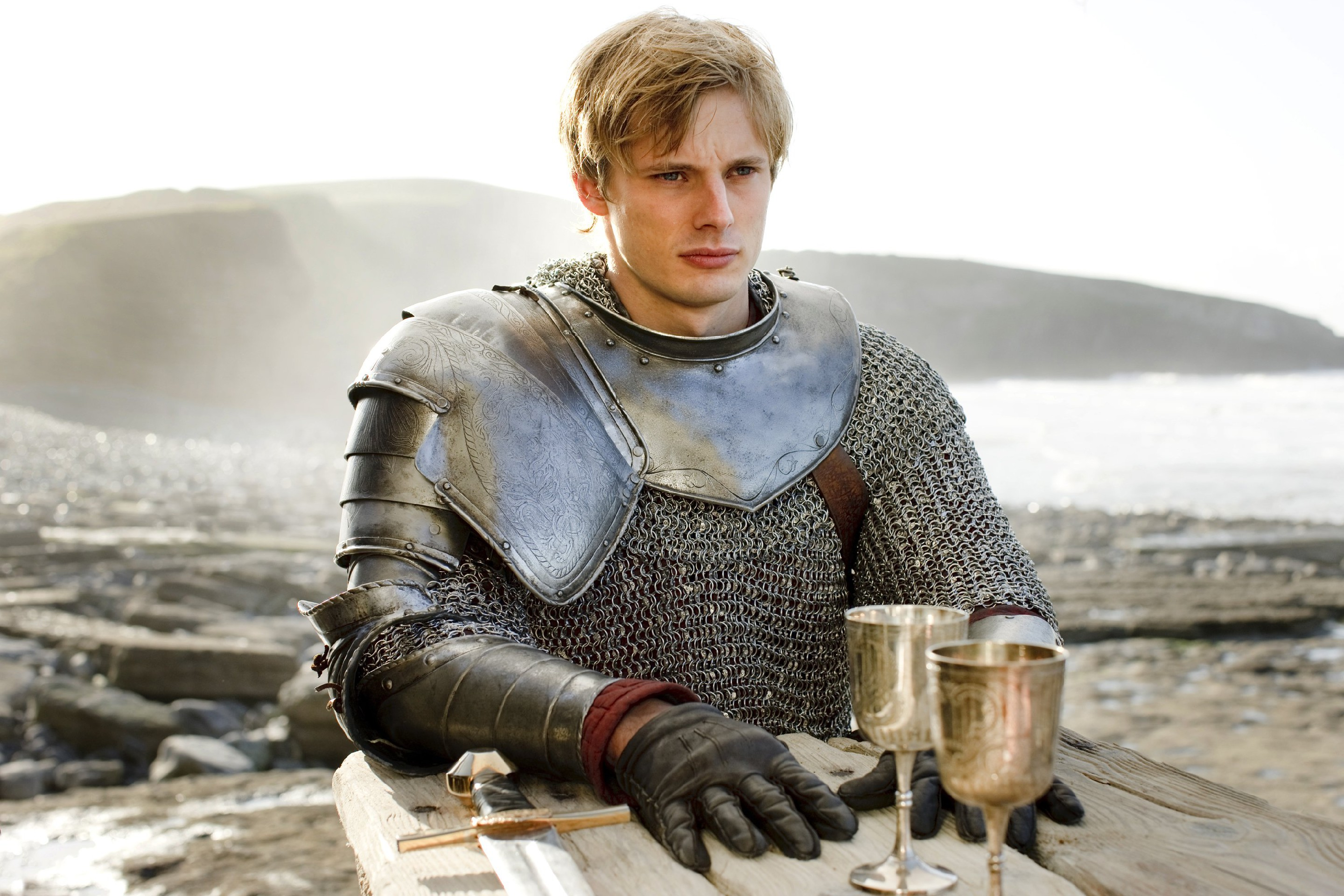 Prince Arthur prepares to drink poison to save Merlin