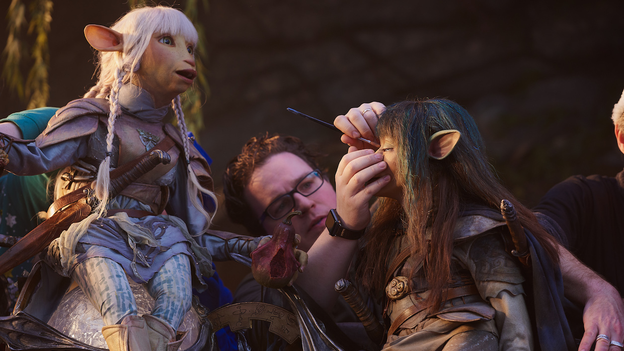 Somone on set of The Dark Crystal: Age Of Resistance, making final touches to the Gelfling puppets Mira and Rian.