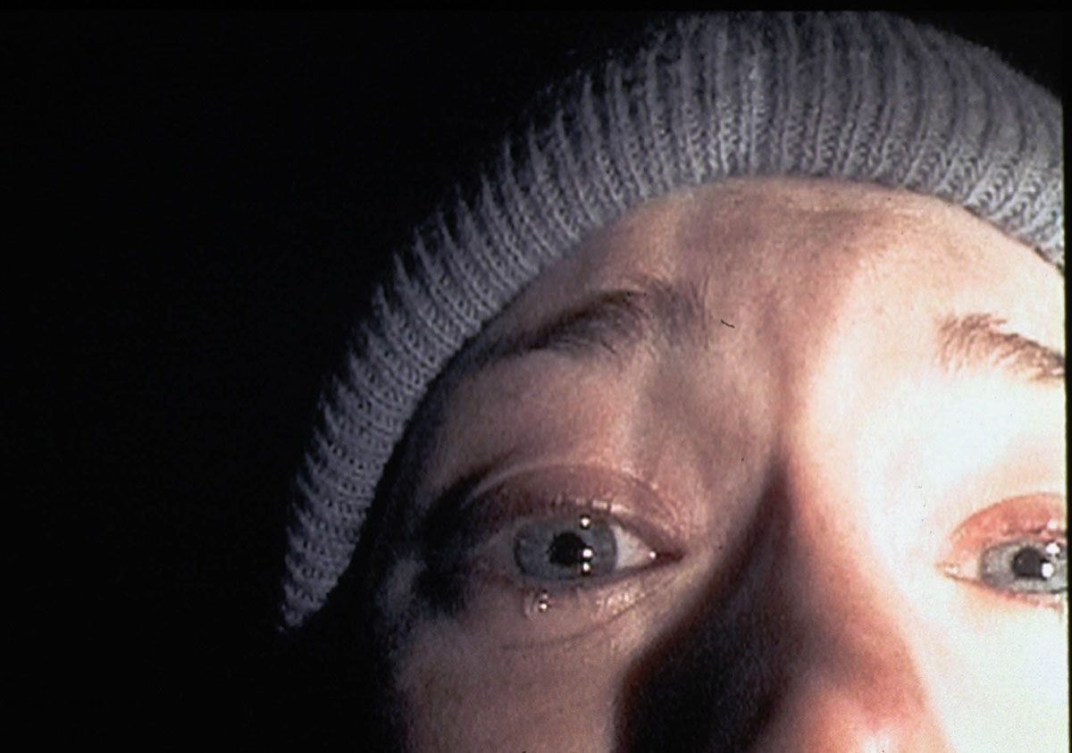 Heather in the iconic apology scene from the horror film, The Blair Witch Project.