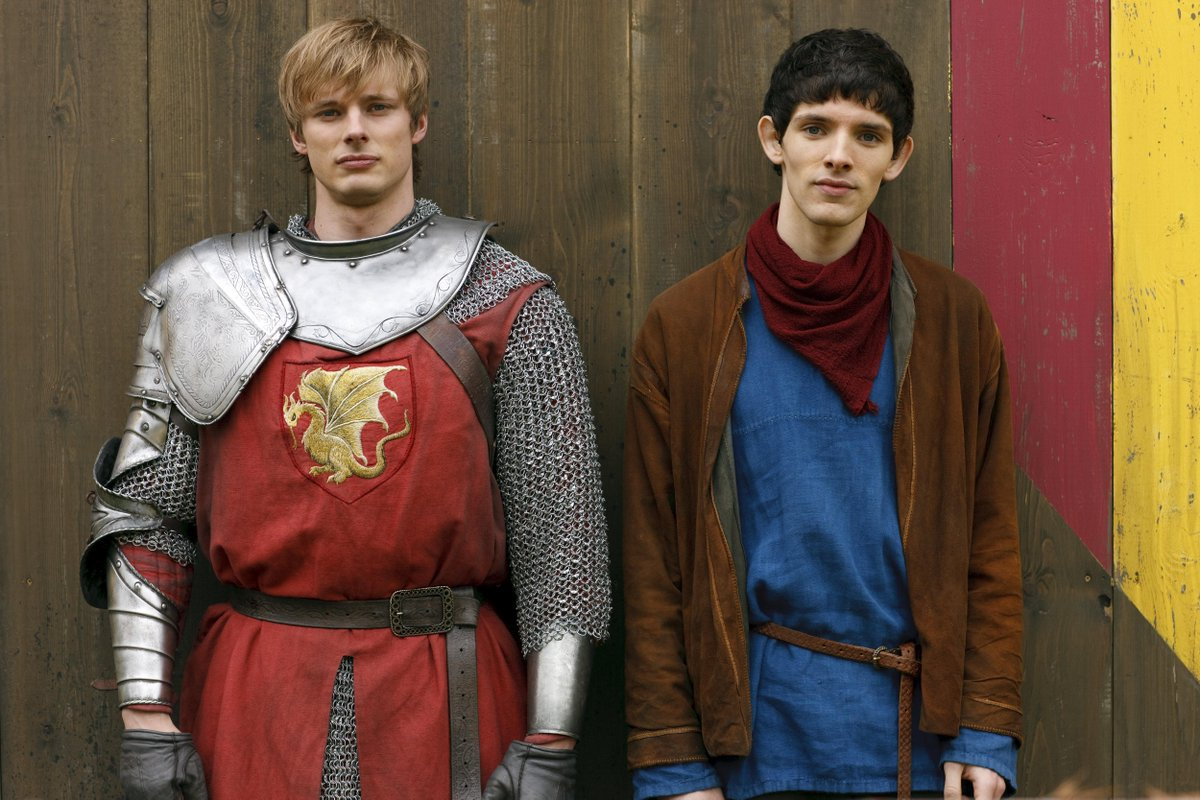 Merlin and Arthur Pendragon stand next to each other early in their friendship.