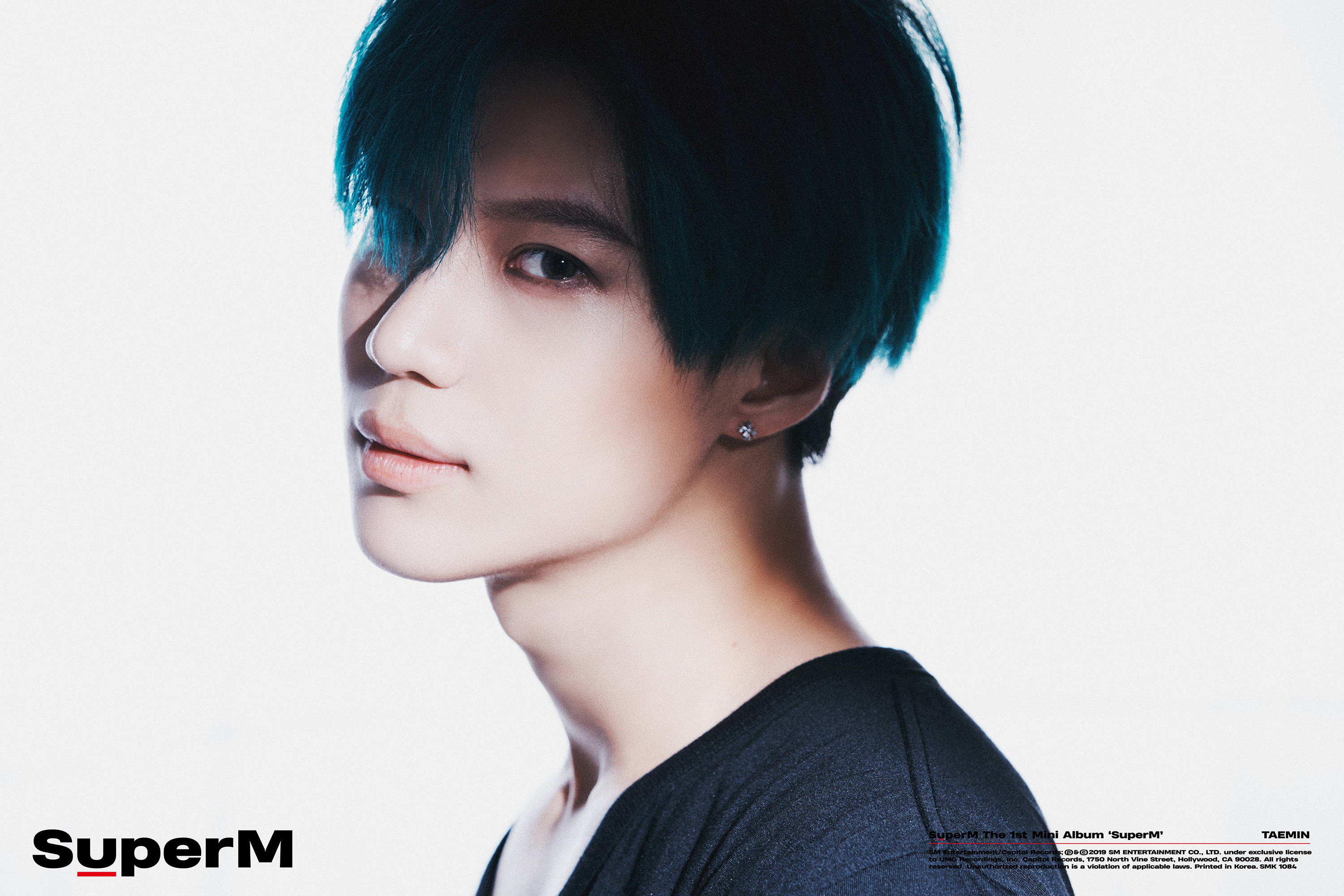 Taemin, sporting blue hair, looks into the camera for his portrait teaser.