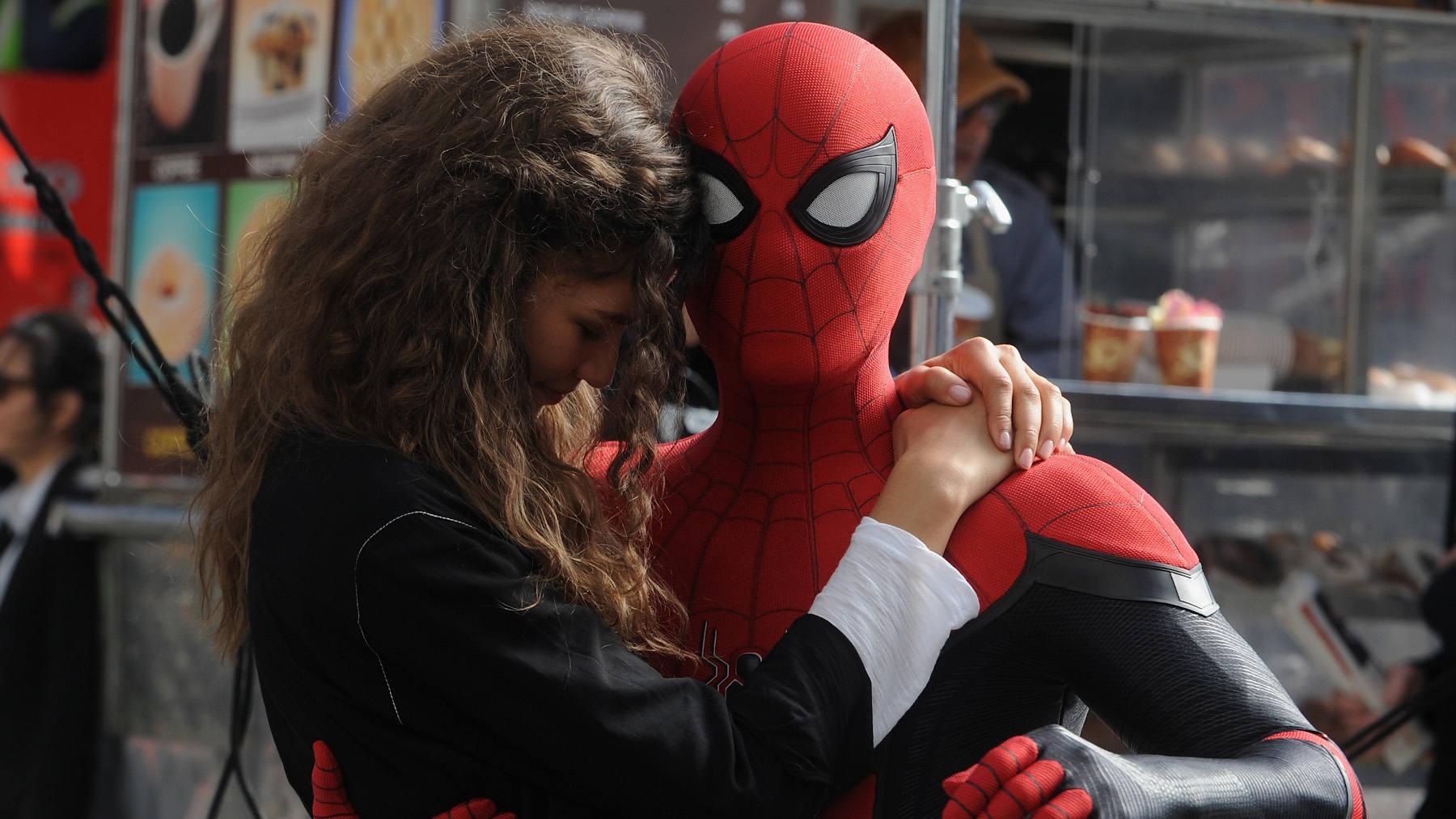 MJ (Zendaya) and Peter Parker (Tom Holland) take flight