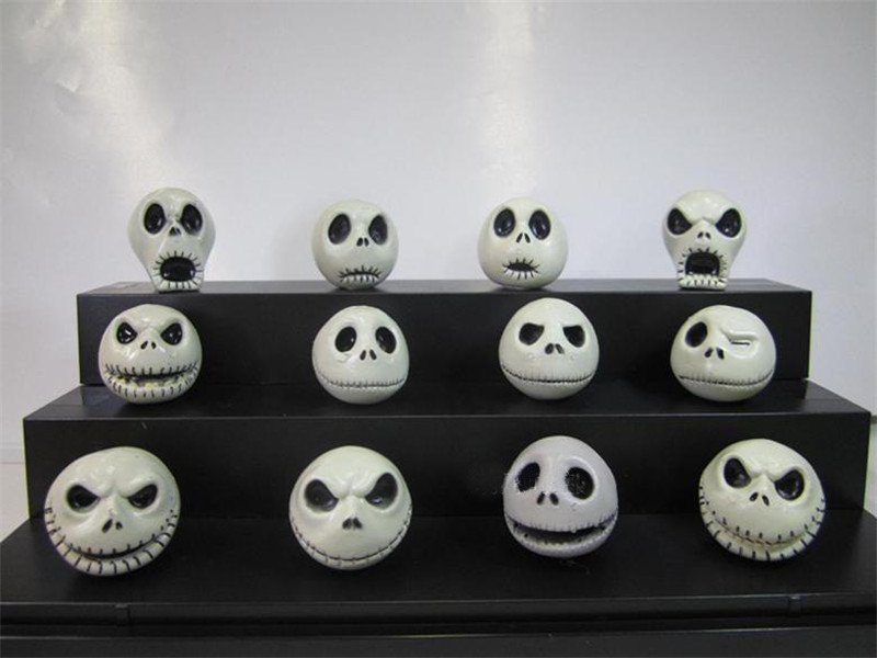 12 claymation heads of Jack Skellington from The Nightmare Before Christmas