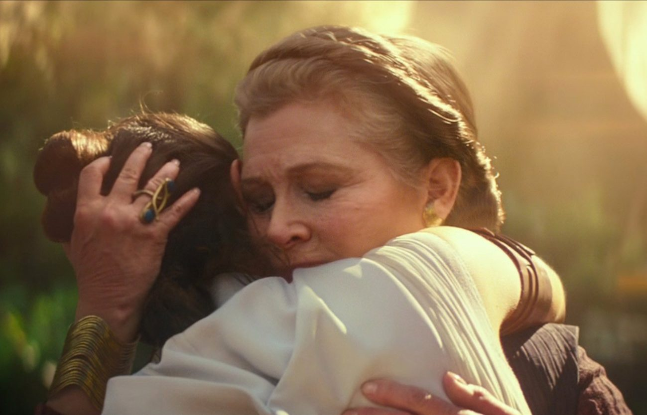 Princess Leia hugging Rey.