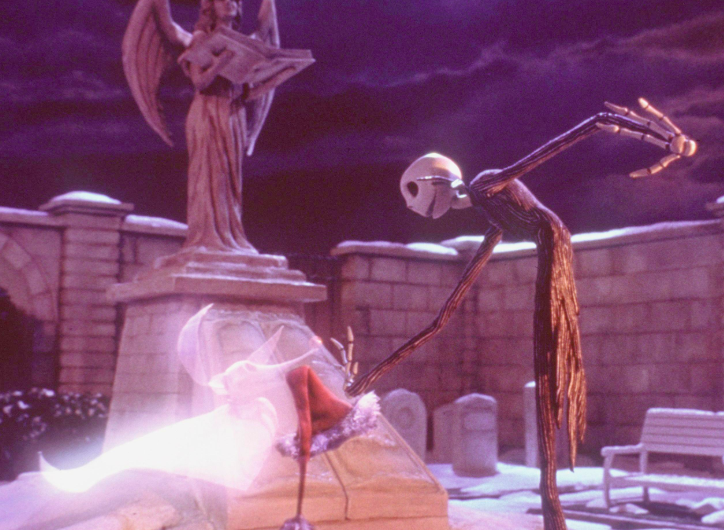 Jack Skellington and Zero, his ghost dog, walking around the cemetery in The Nightmare Before Christmas.