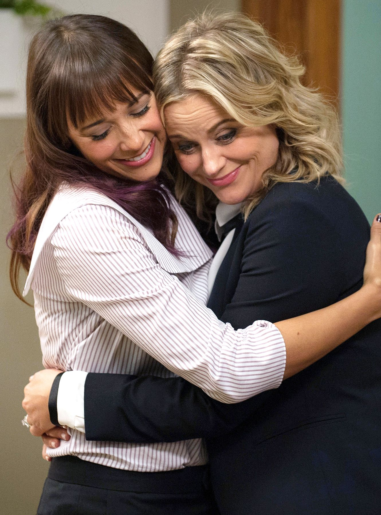 Friendships: Leslie Knope and Ann Perkins hug it out on Parks and Recreation.