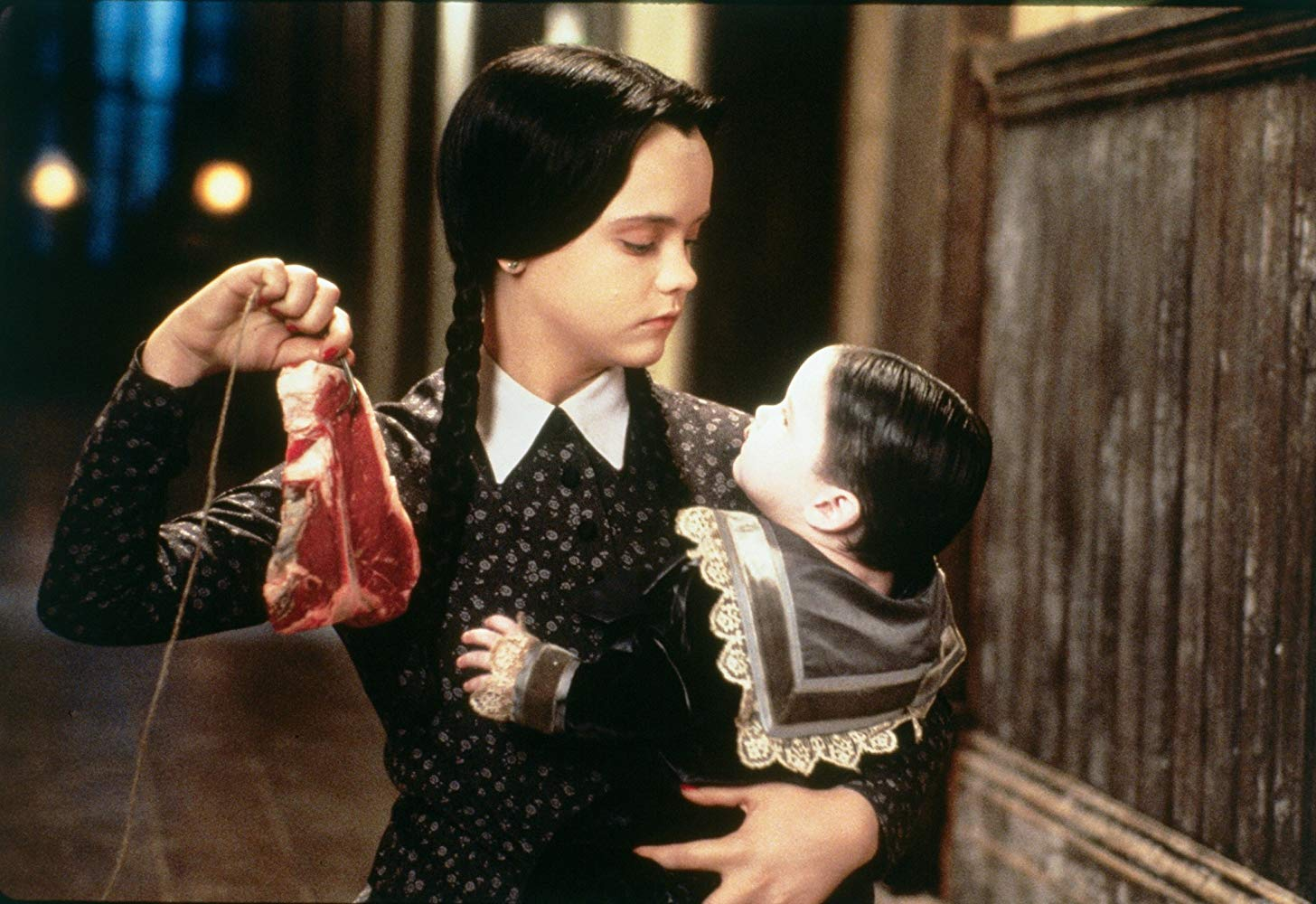 """Wednesday Addams playing with her little brother in """"Addams Family Values."""""""