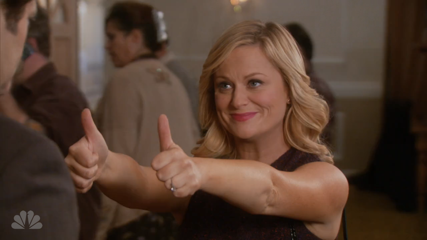 Leslie Knope gives Ron Swanson two thumbs up.