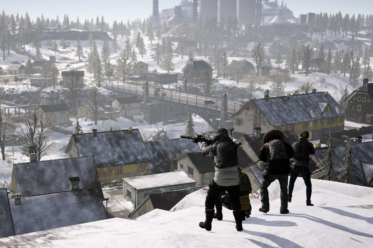 Players aim their rifles atop a mountain in the snowy map, Vikendi.