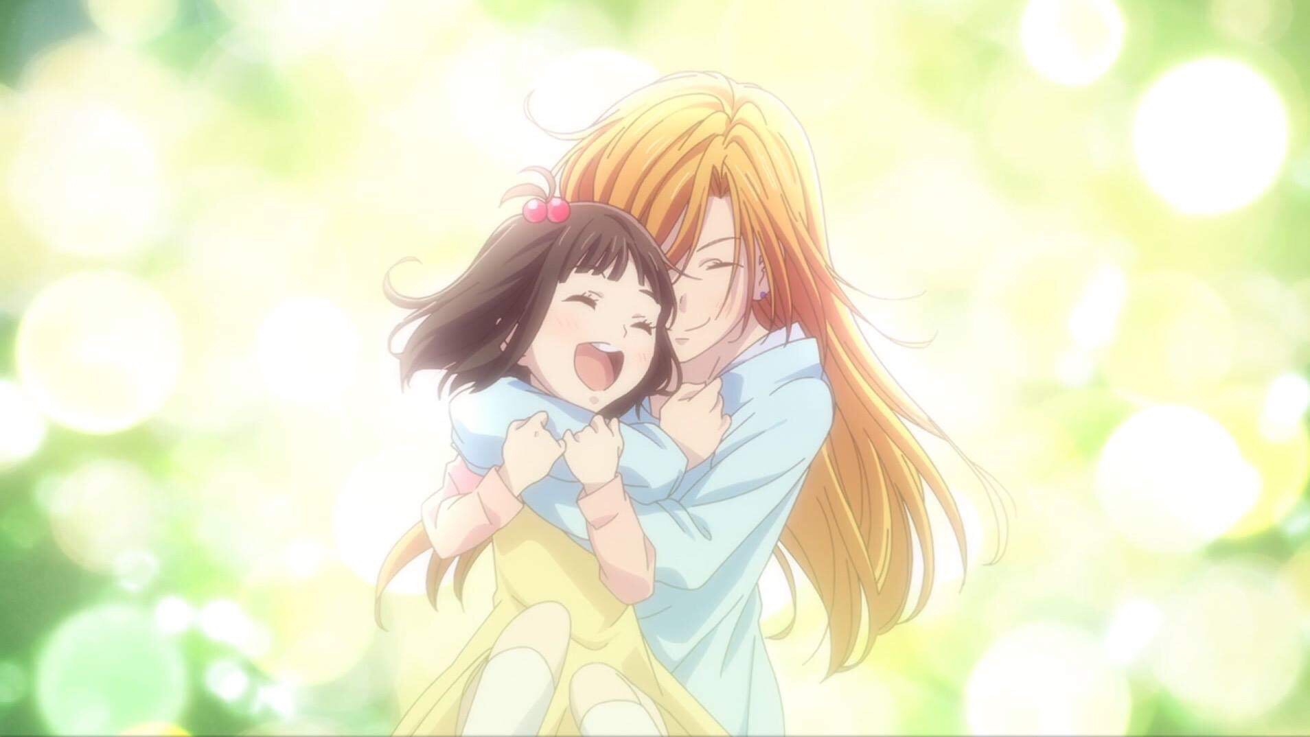 Toruh Honda being hugged by her mother, Kyoko Honda
