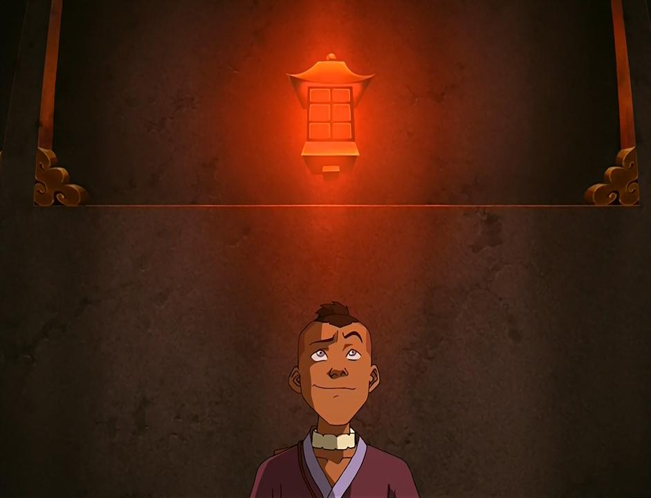Stands under a lightbulb.