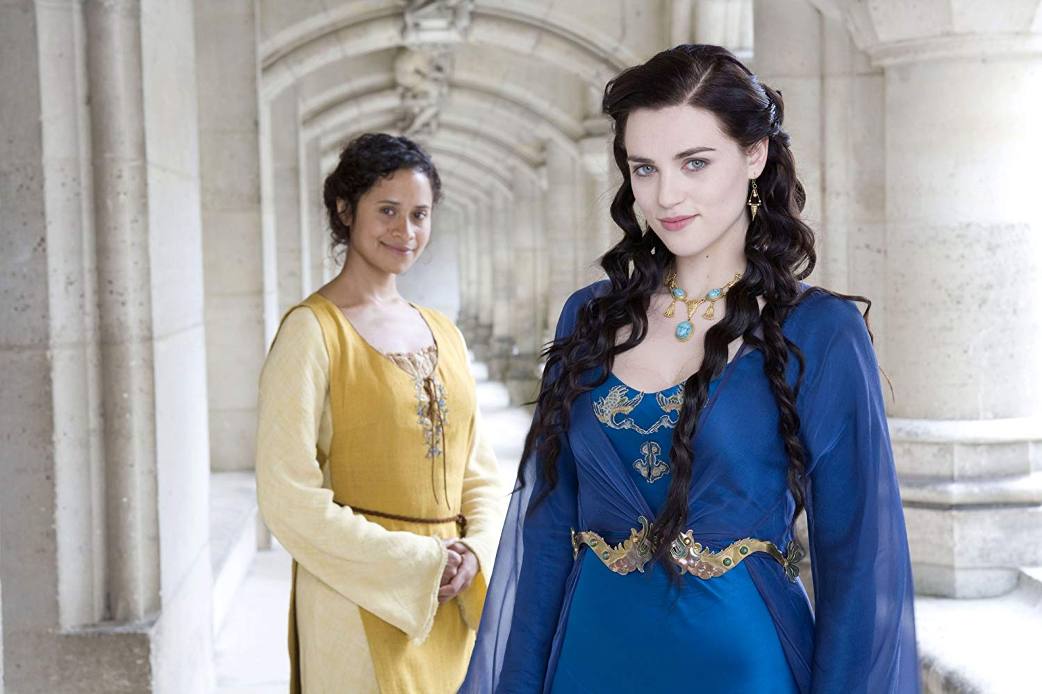 Morgana stands with her maid, Guinevere, in the halls of Camelot
