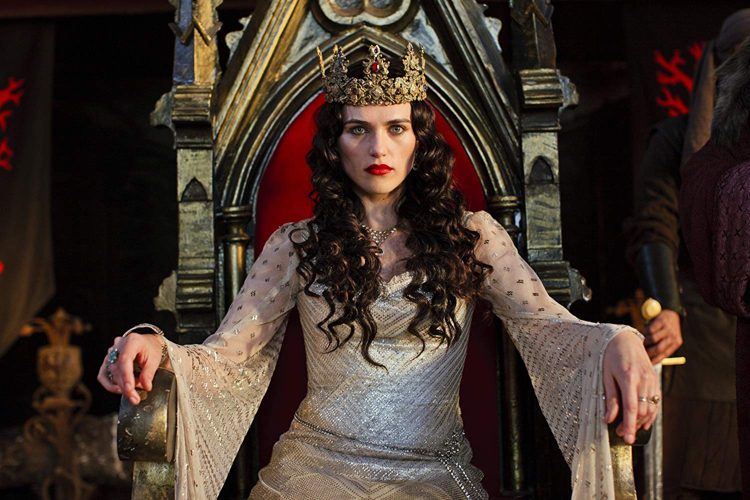 She sits on the throne of Camelot as queen.