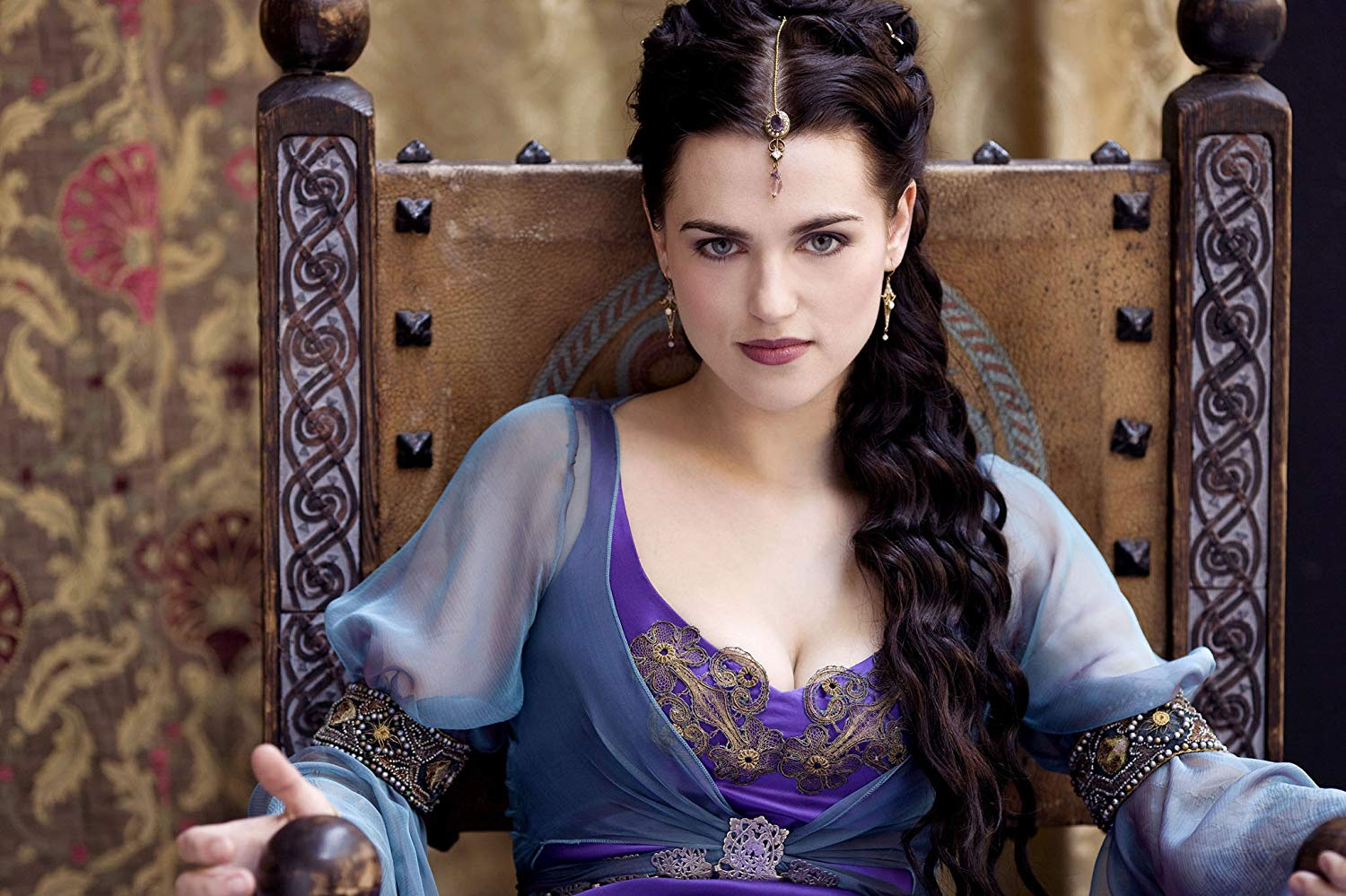 Morgana Pendragon sits on a throne
