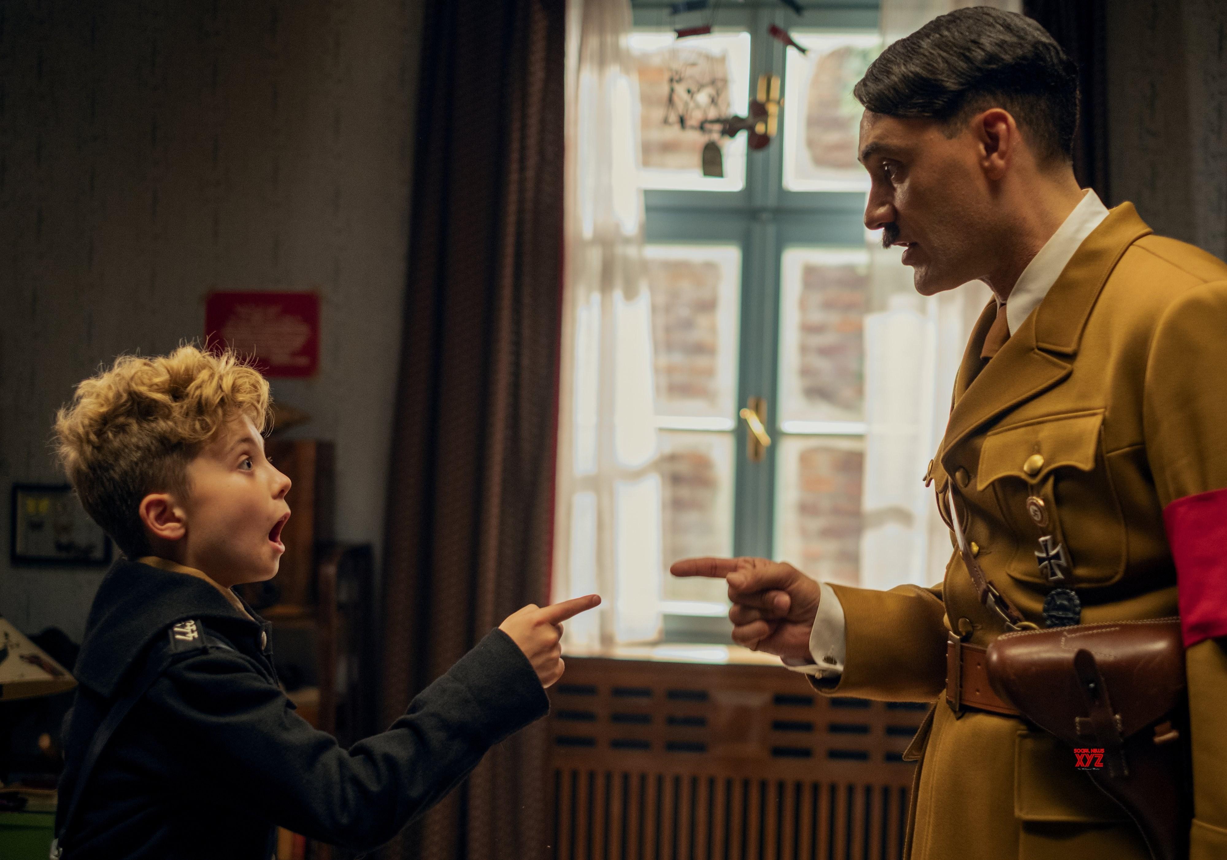 Jojo (Roman Griffin Davis) and Adolph Hitler (Taika Waititi) point at each other.
