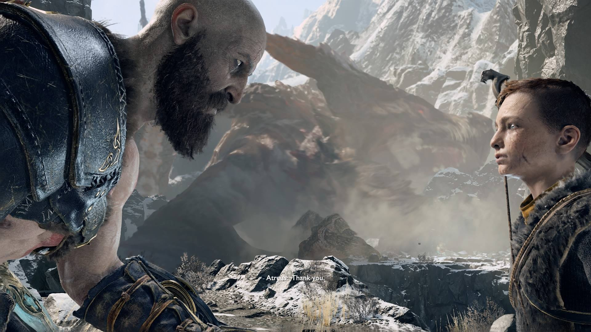 Parents: Kratos looking at his son, Atreus at eye level.