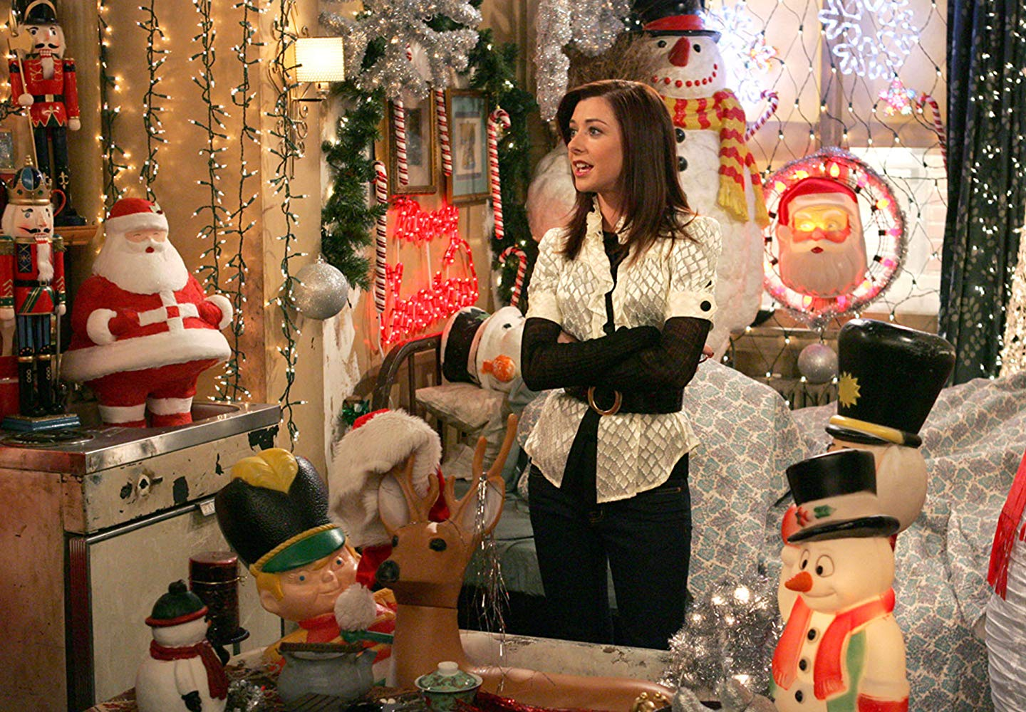 In sitcom How I Met Your Mother, Lily stands in her apartment surrounded by Christmas decorations