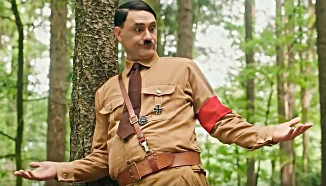 Adolph Hitler (Taika Waititi) shrugs.