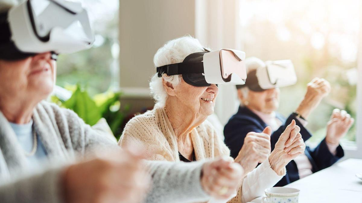 Older ladies trying out Virtual Reality (VR).