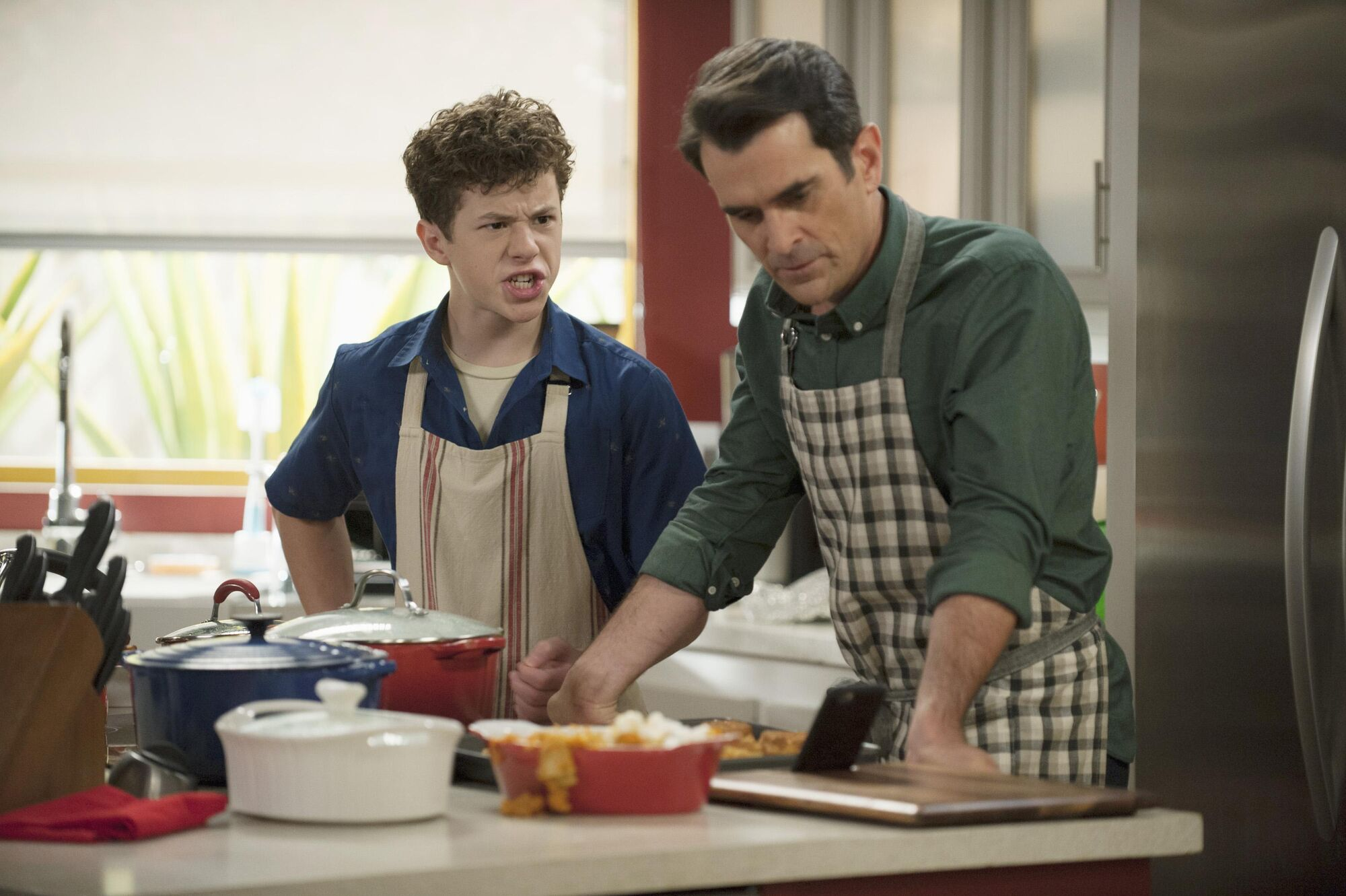 Phil and Luke Dunphy cooking turkey on Modern Family's season 6 thanksgiving special.