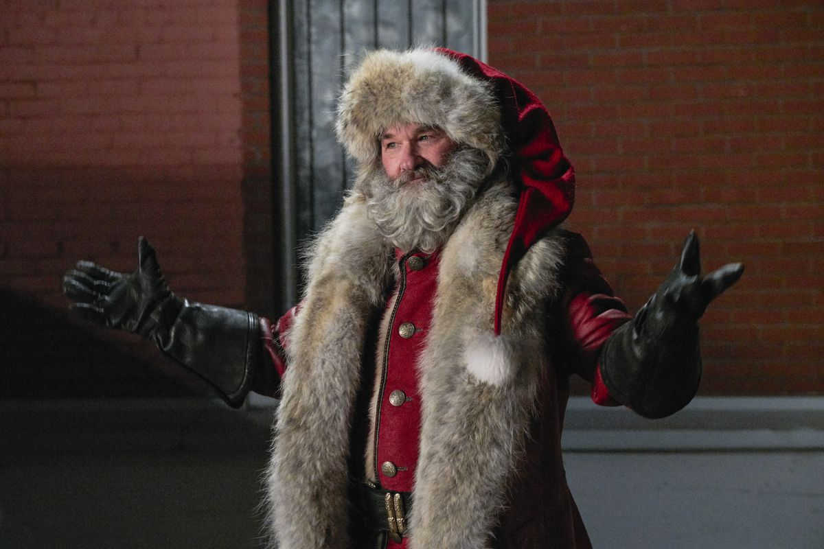Santa looking proud of himself with a fur lined red leather duster.