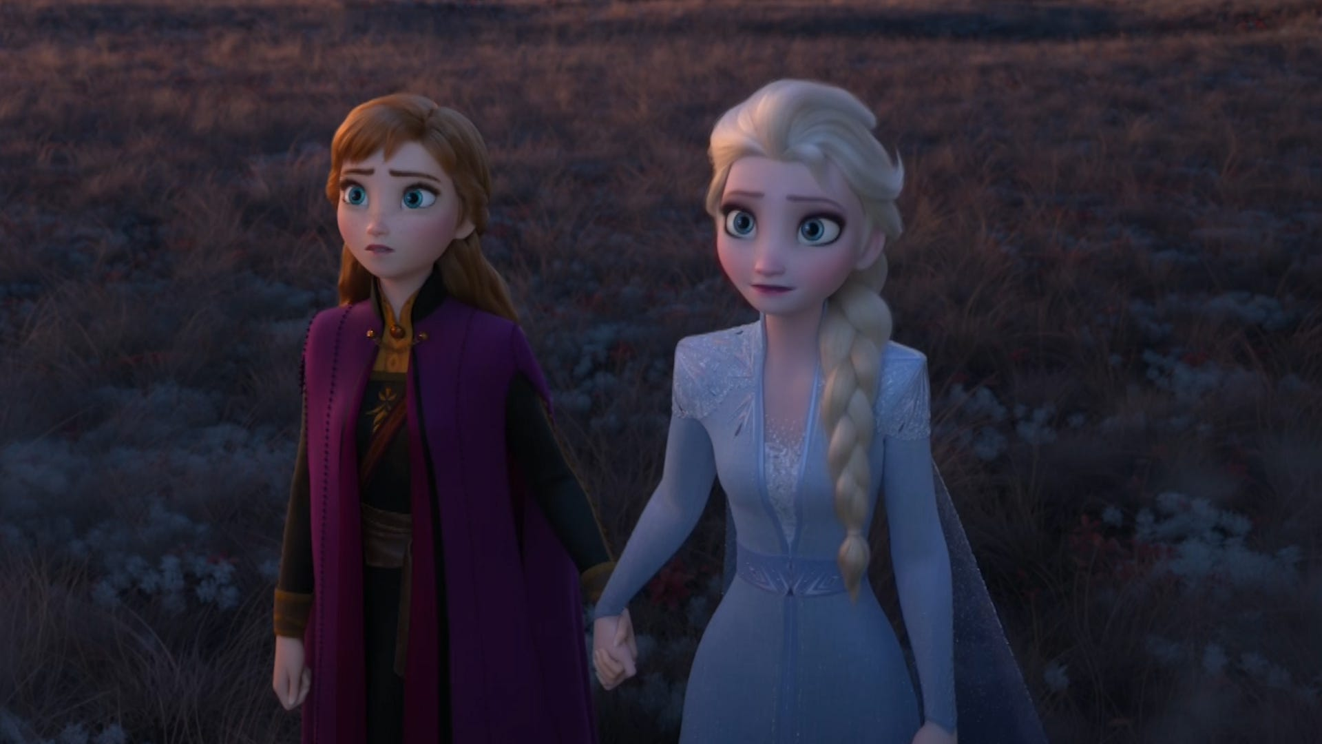 Anna and Elsa holding hands and looking into an abyss.