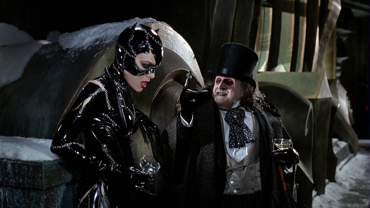 Catwoman and the Penguin talk on a rooftop in this non-traditional Christmas movie.