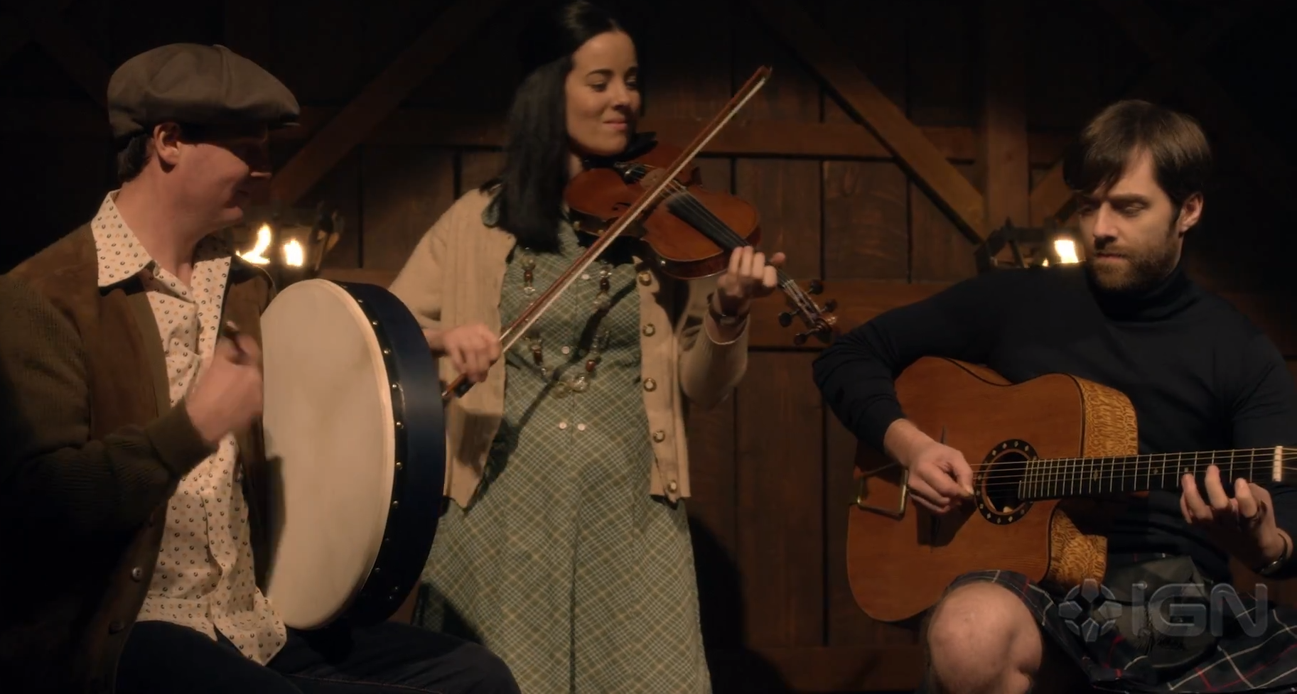 Roger on stage with a band at Scottish festival in season 4, episode 3 of Outlander.