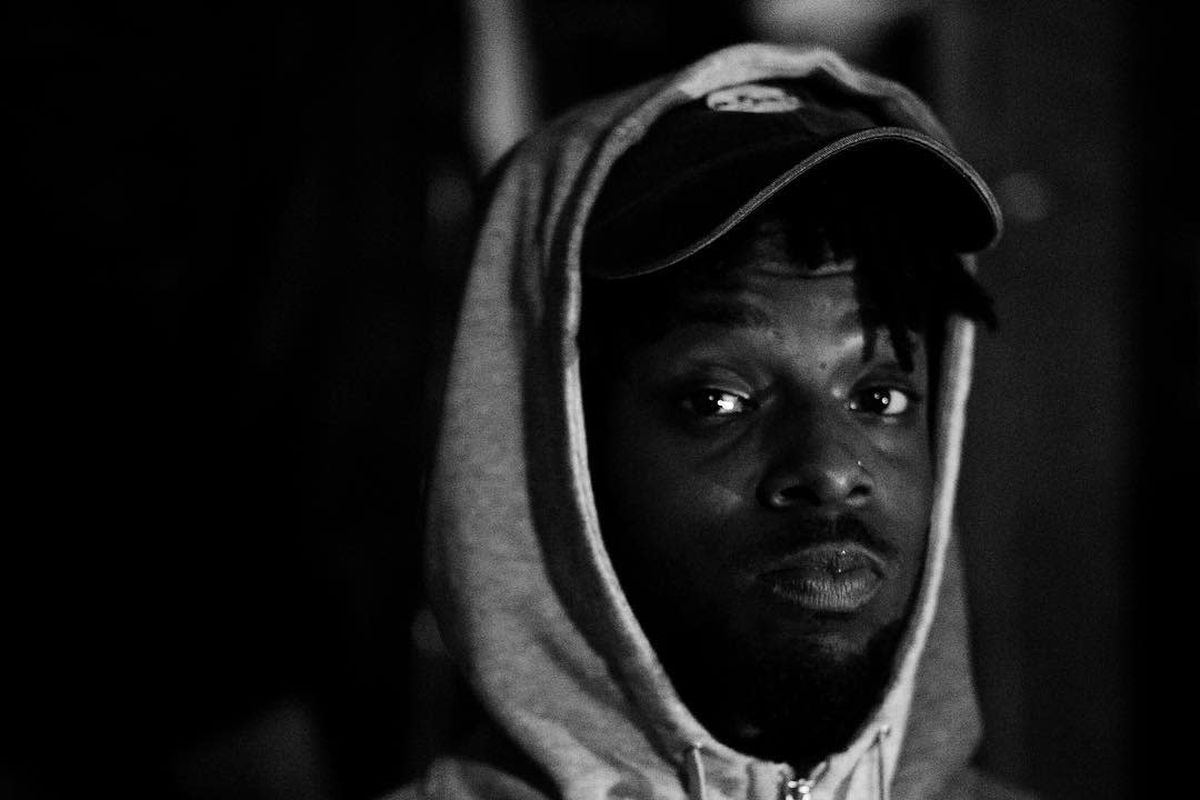 Isaiah Rashad in black and white looking into the lens of the camera.