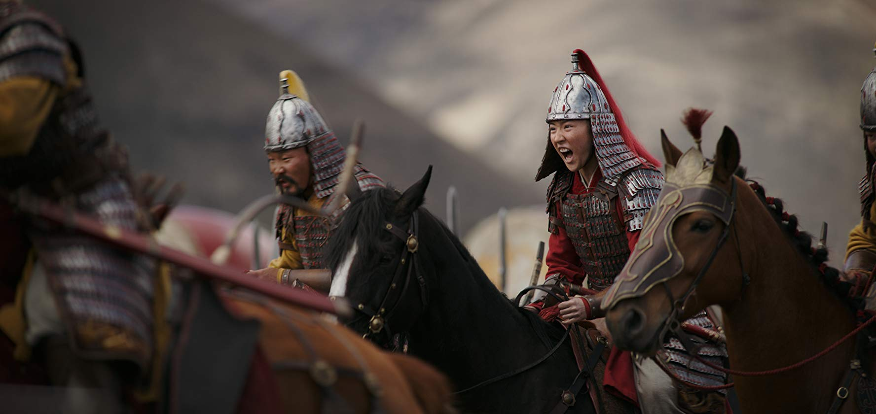 Mulan rides into battle in the live action Mulan
