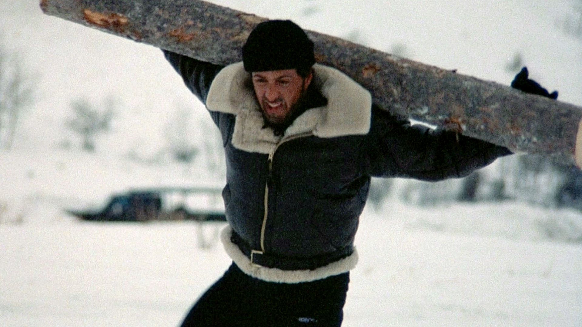 Rocky Balboa trains in the winter by carrying a log in this non-traditional Christmas movie.